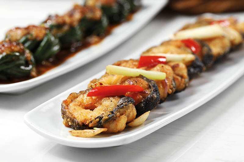 先煎後焗的「順德煎焗風鱔」表皮酥香,口感細緻,爽口鮮甜。(580元)(攝影/于魯光)