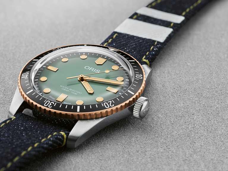 ORIS「ORIS x MOMOTARO」限量腕錶,不鏽鋼、青銅錶殼,40mm,防水100米╱65,000元。(圖╱ORIS提供)