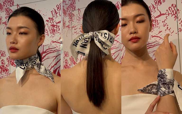 王陽明現場更指導絲巾的時尚綁法。(圖/黃筱婷攝影)