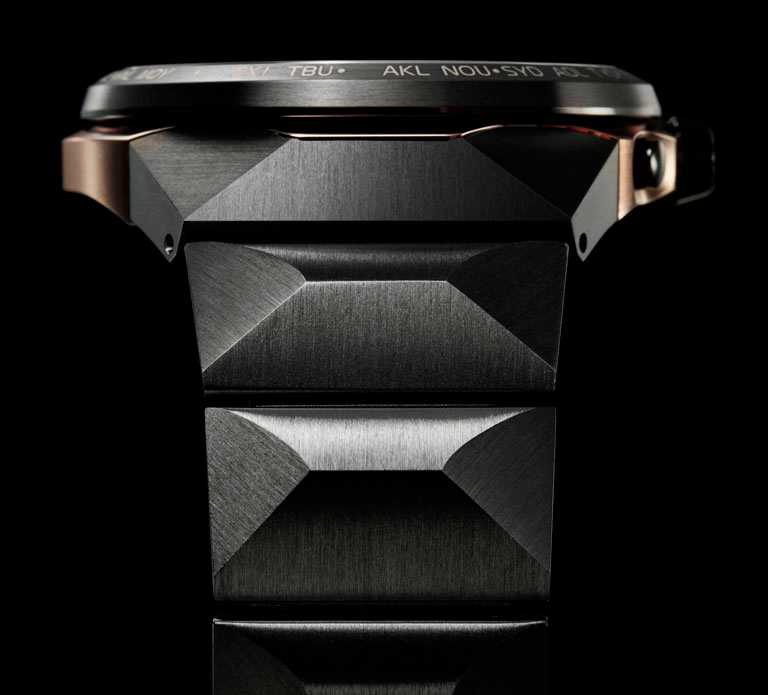 CITIZEN「CC4025-82E」旗艦紀念限量腕錶,迷霧黑DLC鈦金屬錶帶,運用俐落的切面設計構造,展現陽剛魅力。(圖╱CITIZEN提供)