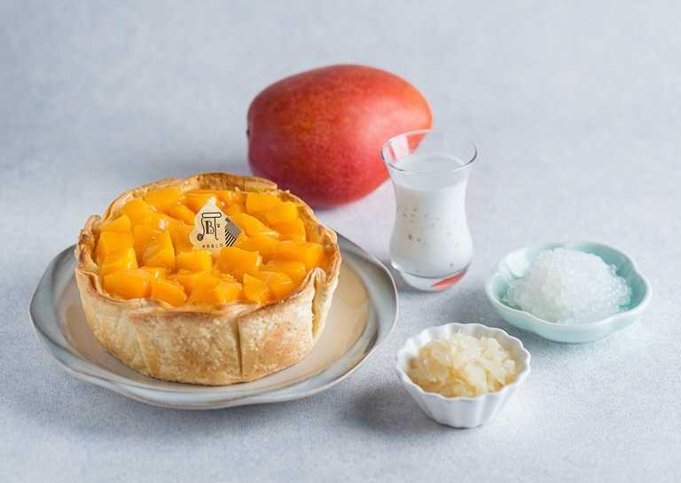 「PABLO楊枝甘露起司塔」鋪滿香甜的芒果為一大特色。(520元)