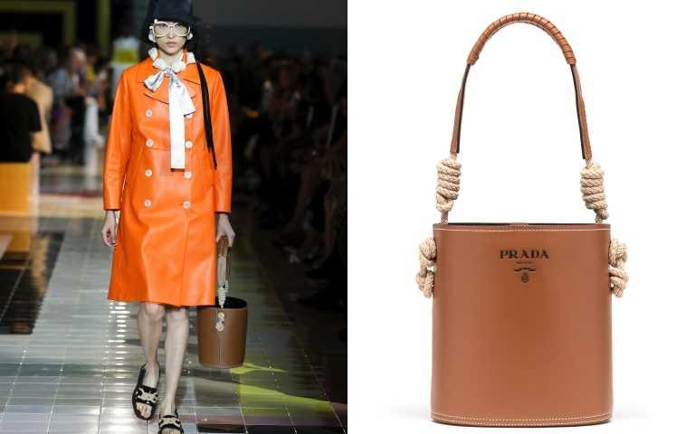 特殊的繩結提帶,讓簡約的皮革包型多了變化。PRADA Leather bucket bag with cord detail 包/約69,200元(圖/品牌提供)