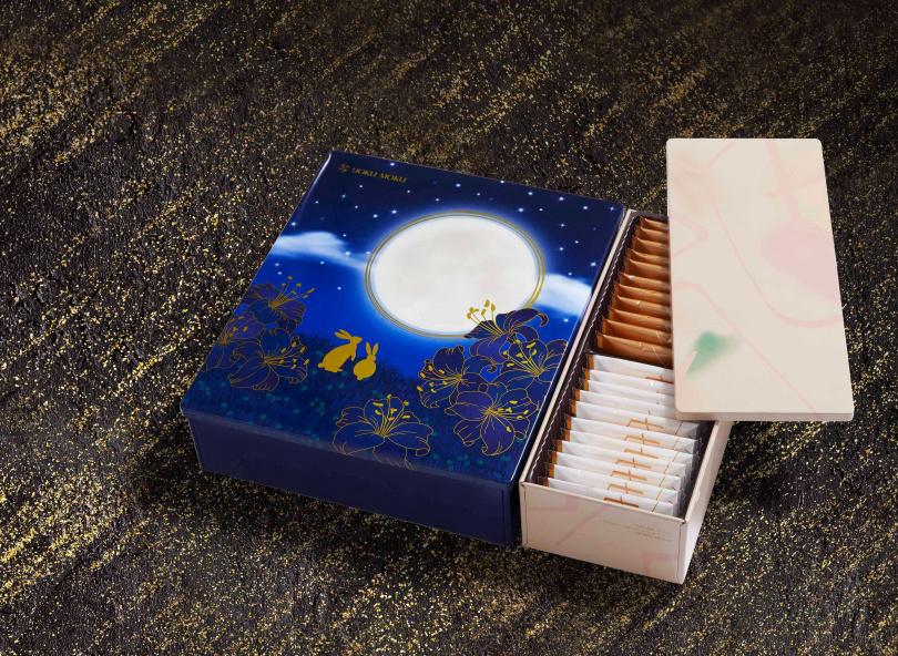 除了金裝版的原味雪茄蛋捲,「雙拼禮盒」還多了濃郁香酥的雙層巧克力薄片和雙層白巧克力薄片。(圖片提供/YOKU MOKU)