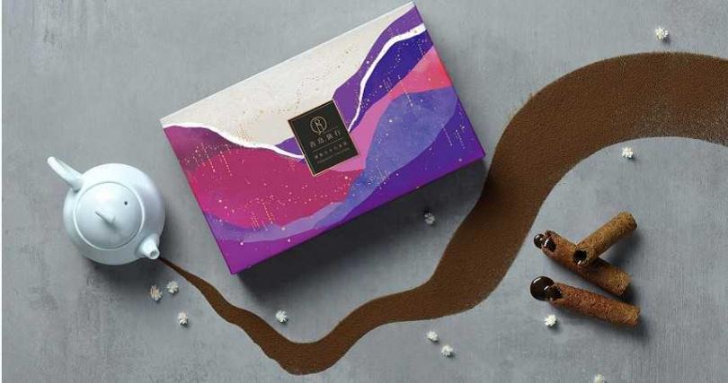 「鐵觀音真巧蛋捲」的包裝設計結合清晨破曉的產茶山林意象。(圖/青鳥旅行提供)