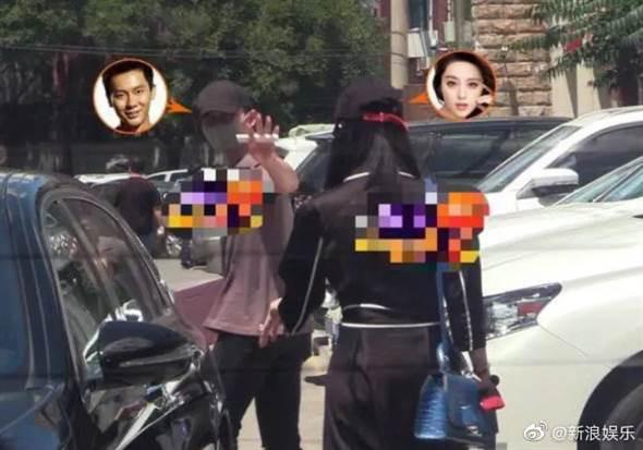 兩人步出餐廳牽車,李晨依依不捨向范冰冰揮手再見。(圖/翻攝自新浪娛樂微博)