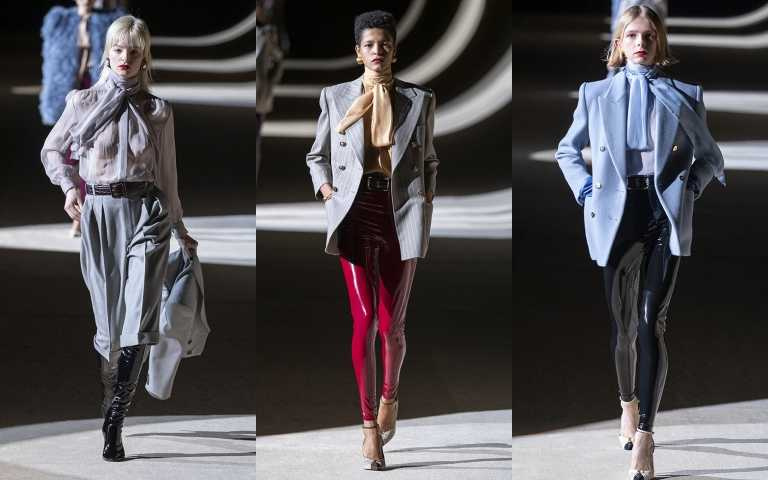光滑乳膠材質的時髦緊身褲,搭配極度強勢的外套風格,但不忘用脖子上的絲巾領結透膚上衣營造柔美去平衡,展現復古懷舊的情懷。(圖/SAINT LAURENT提供)