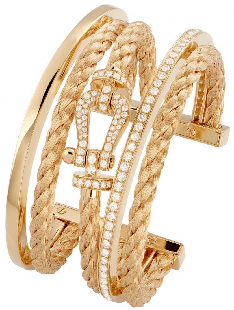 FRED「Force 10」系列高級珠寶,黃K金鑲鑽三環手環╱1,082,400元。(圖╱FRED提供)