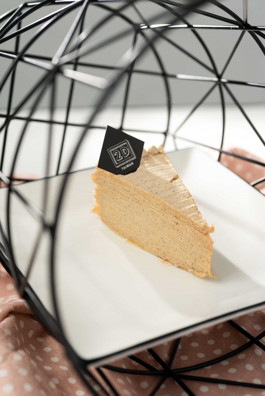刻意降低鮮奶油的比例,讓「伯爵茶千層蛋糕」吃起來甜而不膩。(180元)