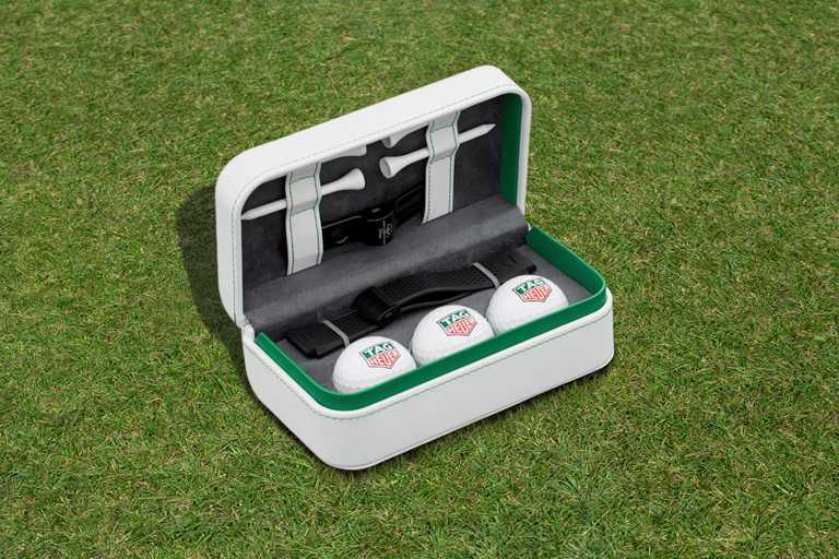 TAG HEUER「CONNECTED智能腕錶」高爾夫球特別版╱錶盒包含:4個高爾夫球座、1個整草器、3顆高爾夫球,及1條黑色備用橡膠錶帶。(圖╱TAG HEUER提供)