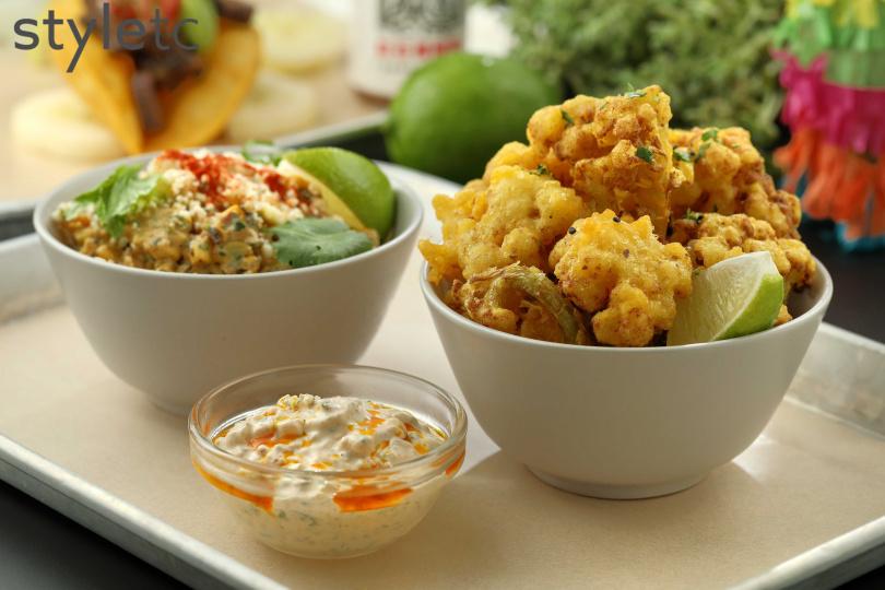 以日式天婦羅的油炸手法,讓炸白花椰菜吃起來清爽不油膩。(150元)(圖/于魯光攝)