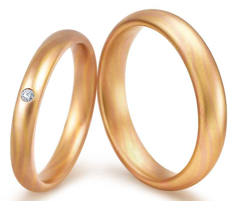 PROMESSA「相融」18K黃金玫瑰金雙色對戒╱男戒44,800元;女戒37,500元。(圖╱點睛品提供)