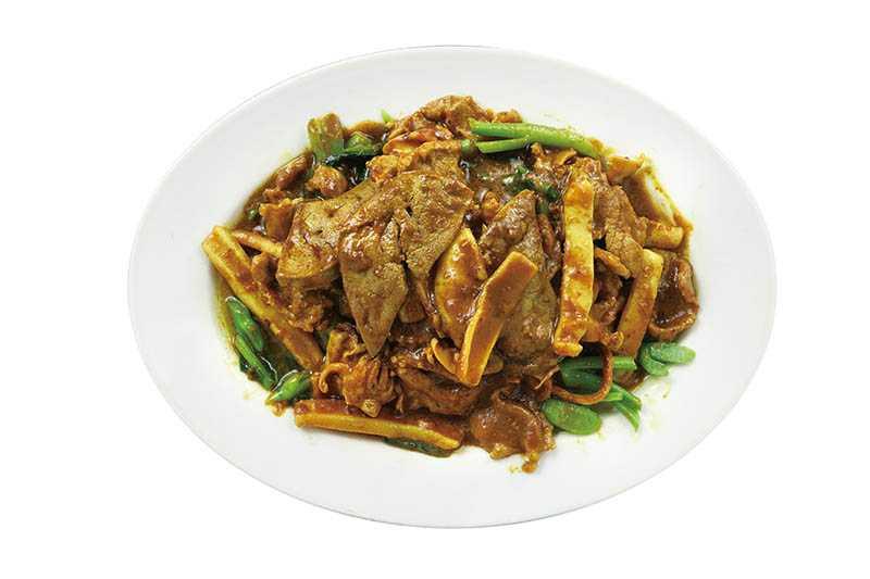將豬肉、豬肝及小卷一同拌炒的「炒三鮮」是不少客人必點料理。(275元)(圖/于魯光)