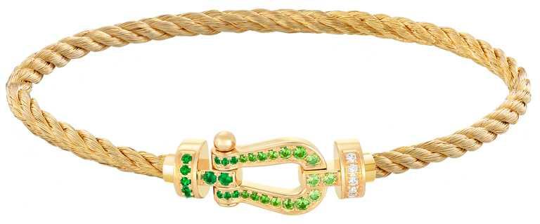 FRED「Force 10」系列手環,18K金祖母綠鑽石鍊釦(中型款)╱209,700元。(圖╱FRED提供)